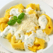 Stock Photo: Ricotta and spinach tortelloni with cream sauce and Parmesan