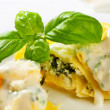 Ricotta and spinach tortelloni with cream sauce and Parmesan — Stock Photo #32126131
