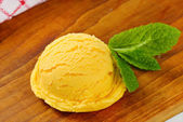 Scoop of yellow sorbet — Stock Photo