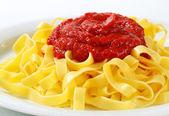 Tagliatelle pasta with tomato paste — Stock Photo