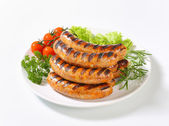 Grilled bratwursts — Stock Photo