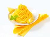 Swirl of yellow cream — Stock Photo