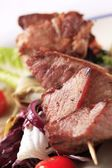 Pork skewer with vegetables — Stock Photo