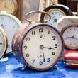 Old clocks at flea market — Stock Photo