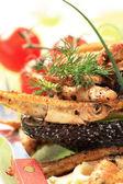 Crunchy fried sprats on avocado — Stock Photo