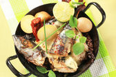 Pan fried mackerel with cream sauce and new potatoes — Stock Photo