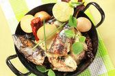 Pan fried mackerel with cream sauce and new potatoes — Stock Photo