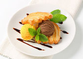 Ice cream with puff pastry biscuits — Stock Photo