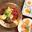 Stock Photo: Fried eggs and vegetable garnish