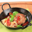 Meat patty with tomatoes and spaghetti — Stock Photo