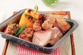 Pork meat in a roasted pan — Stock Photo