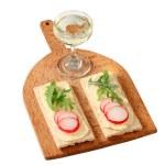 Crispbread with butter, radish and arugula — Stock Photo