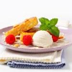 Almond cake with ice cream and raspberries — Stock Photo #38061021
