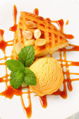 Almond cake with ice cream and caramel sauce — Stock Photo