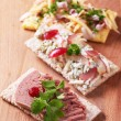 Stok fotoğraf: Crispbread with various savory toppings