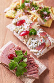 Crispbread with various savory toppings — Stok fotoğraf
