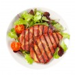 Grilled pork with salad greens — Stock Photo