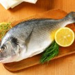 Stock Photo: Fresh sebream on cutting board