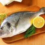 Fresh sea bream on cutting board — Stock Photo