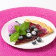 Stock Photo: Slice of blueberry tart with ice cream