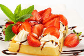 Crisp waffle with  strawberries and cream — Stock Photo