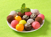 Assorted chocolate truffles and pralines — Stock Photo