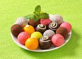 Assorted chocolate truffles and pralines — Stock Photo
