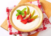 Milk pudding with fruit — Stock Photo