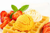 Waffle with ice cream and strawberries — Stock Photo