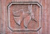 Paloma de la paz, relieve de piedra — Foto de Stock