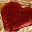 Red valentine on gold fabric background — Stock Photo