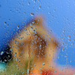 Out of Focus Country House behind Wet Glass — Stock Photo #12252640