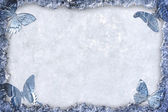 Blue ice framed background with butterflies — Stock Photo