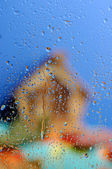 Out of Focus Country House behind Wet Glass — Stock Photo