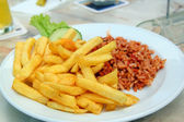 French fries and djuvec rice — Stock Photo
