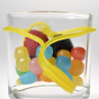 Colored candy in a glass jar — Stock Photo #14153426