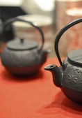 Iron asian teapot with sprigs of mint for tea — Stock Photo