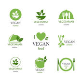 Vector Vegan and Vegetarian Food Emblems — Stock Vector
