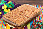 Whole sheetcake of a cajun cake with praline topping. — Stock Photo