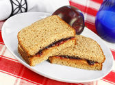 Healthy lunch of Peanut Butter and Jelly Sandwich on Whole Wheat — Stock Photo