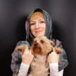 Girl with a Yorkshire terrier — Stock Photo