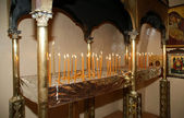Burning candles in the Christian church — Stockfoto