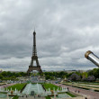 Telescope viewer and Eiffel Tower in Paris - Stock Photo