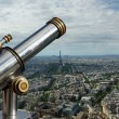 Telescope viewer and city skyline at daytime. Paris, France - Stockfoto