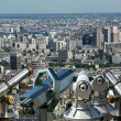 Telescope viewer and city skyline at daytime. Paris, France. — Stock Photo #18405733