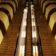 Elevators in atrium of hotel — Stock Photo