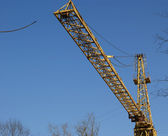 Construction tower crane at a construction site — Zdjęcie stockowe