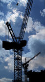 Cranes on a construction site. Industrial image — Stock Photo