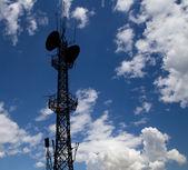 Communication transmitter against a sky background — Stock Photo
