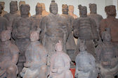 Terracotta army statues at a market stall for sale, Xian (Sian), China — Stock Photo